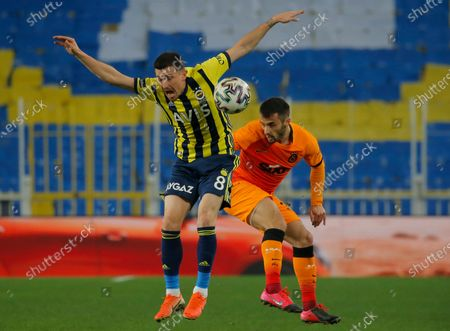 Mesut Ozil, the former Germany soccer midfielder, warms up prior to a Turkish Super League soccer match between Fenerbahce and Galatasary in Istanbul, . Ozil, formerly with Arsenal had signed with Fenerbahce soccer club
