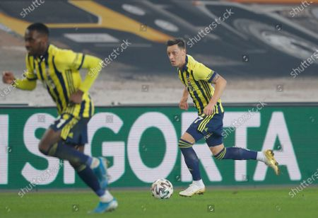 Fenerbahce's Mesut Ozil, of Germany, controls the ball during a Turkish Super League soccer match between Fenerbahce and Galatasaray in Istanbul, . Ozil, who is of Turkish descent and was formerly with Arsenal came in as a substitute on his first match with Fenerbahce. Galatasaray won the match 1-0