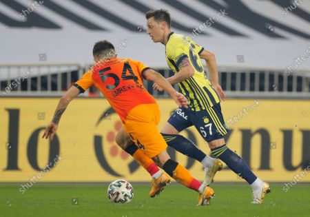 Fenerbahce's Mesut Ozil, of Germany, runs with the ball during a Turkish Super League soccer match between Fenerbahce and Galatasaray in Istanbul, . Ozil, who is of Turkish descent and was formerly with Arsenal came in as a substitute on his first match with Fenerbahce. Galatasaray won the match 1-0