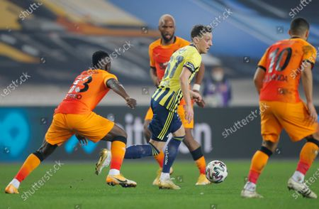 Fenerbahce's Mesut Ozil, of Germany, center runs with the ball during a Turkish Super League soccer match between Fenerbahce and Galatasaray in Istanbul, . Ozil, who is of Turkish descent and was formerly with Arsenal came in as a substitute on his first match with Fenerbahce. Galatasaray won the match 1-0