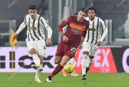 Juventus' Alvaro Morata (L) and Roma's Gianluca Mancini (C) in action during the Italian Serie A soccer match Juventus FC vs AS Roma at the Allianz Stadium in Turin, Italy, 06 february 2021.