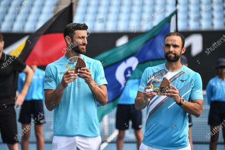 Stock Picture of Juan Sebastián Cabal and Robert Farah pose with their runners-up trophies after losing the doubles final