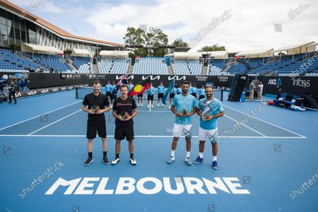 Jamie Murray ad Bruno Soares pose with the winners trophy alongside Juan Sebastián Cabal and Robert Farah after winning the doubles final
