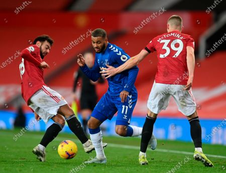 Everton's Joshua King (C) in action against Manchester United's Bruno Fernandes (L) and Scott McTominay (R) during the English Premier League soccer match between Manchester United and Everton FC in Manchester, Britain, 06 February 2021.