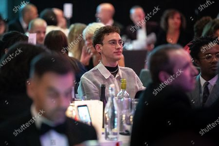 Olly Alexander in the audience. The cast of Russell T Davies ' TV drama It's a Sin attend a George House Trust fundraising gala at the Lowry Hotel in Salford.
