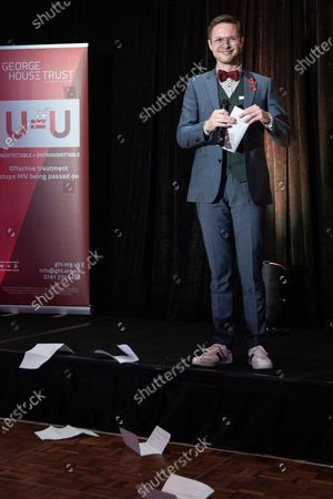 Nathaniel Hall performs on the stage. The cast of Russell T Davies ' TV drama It's a Sin attend a George House Trust fundraising gala at the Lowry Hotel in Salford.