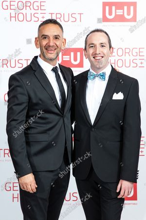 NEIL ASHTON and DAVID CARLYLE. The cast of Russell T Davies ' TV drama It's a Sin attend a George House Trust fundraising gala at the Lowry Hotel in Salford.