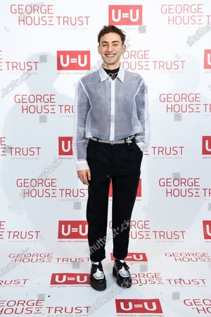 Olly Alexander. The cast of Russell T Davies ' TV drama It's a Sin attend a George House Trust fundraising gala at the Lowry Hotel in Salford.