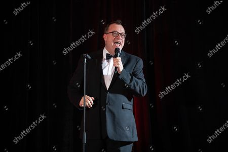 Russell T Davies speaks at the gala. The cast of Russell T Davies ' TV drama It's a Sin attend a George House Trust fundraising gala at the Lowry Hotel in Salford.