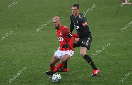 OHL's Toon Raemaekers and Standard's Mehdi Carcela fight for the ball during a soccer match between Standard de Liege and Oud-Heverlee Leuven, Saturday 06 February 2021 in Liege, on day 24 of the 'Jupiler Pro League' first division of the Belgian championship.