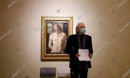 """Director and actor Abel Ferrara reads poems composed by the Italian poet Gabriele Tinti, in front of the painting """"Christ at the Column"""" by 15th Century Italian painter Donato Bramante at the Brera art Gallery, in Milan, Italy"""