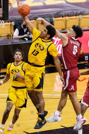 Missouri's Mark Smith, left, shoots past Alabama's Jaden Shackelford, right, during the second half of an NCAA college basketball game, in Columbia, Mo