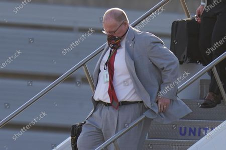 Kansas City Chiefs head coach Andy Reid arrives for the NFL Super Bowl 55 football game against the Tampa Bay Buccaneers, in Tampa, Fla