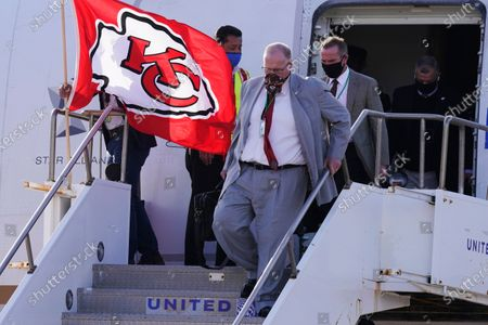 Kansas City Chiefs head coach Andy Reid arrives with his team for the NFL Super Bowl 55 football game against the Tampa Bay Buccaneers, in Tampa, Fla