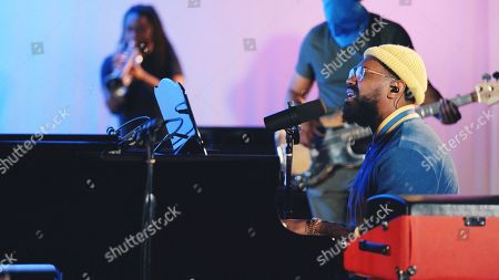Stock Picture of PJ Morton performance with Zacardi Cortez and Darrel Walls