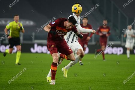 Roger Ibanez of AS Roma and Alvaro Morata of Juventus FCduring the Serie A football match between Juventus and AS Roma. Sporting stadiums around Italy remain under strict restrictions due to the Coronavirus Pandemic as Government social distancing laws prohibit fans inside venues resulting in games being played behind closed doors. Juventus FC won 2-0 over AS Roma.