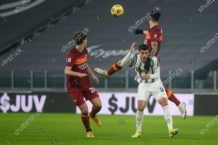 Alvaro Morata of Juventus FC and Roger Ibanez of AS Roma and Marash Kumbulla of AS Roma during the Serie A football match between Juventus and AS Roma. Sporting stadiums around Italy remain under strict restrictions due to the Coronavirus Pandemic as Government social distancing laws prohibit fans inside venues resulting in games being played behind closed doors. Juventus FC won 2-0 over AS Roma.