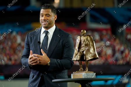 Seattle Seahawks quarterback Russell Wilson speaks after winning the Walter Payton NFL Man of the Year awards at the NFL Honors ceremony as part of Super Bowl 55, in Tampa, Fla
