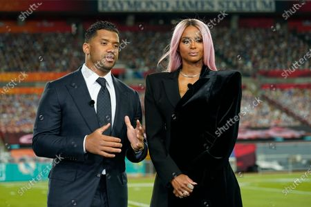 Seattle Seahawks quarterback Russell Wilson and his wife Ciara talk make a statement after Wilson won the Walter Payton NFL Man of the Year awards at the NFL Honors ceremony as part of Super Bowl 55, in Tampa, Fla