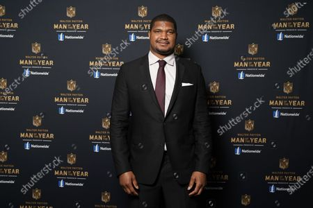 Baltimore Ravens' Calais Campbell poses for a photo before presenting the Walter Payton NFL Man of the Year award during the NFL Honors ceremony as part of Super Bowl 55, in Tampa, Fla