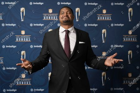 Stock Image of Baltimore Ravens' Calais Campbell poses for a photo before presenting the Walter Payton NFL Man of the Year award during the NFL Honors ceremony as part of Super Bowl 55, in Tampa, Fla