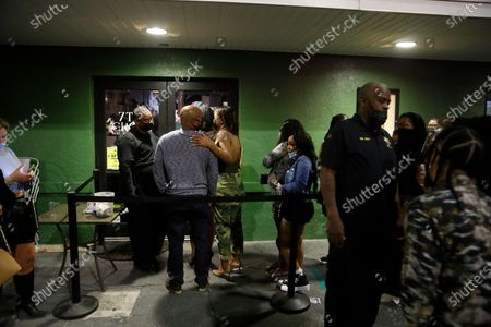 People wait in line to see 2 Chainz perform at 7th & Grove located in the Ybor City district in Tampa, Florida, on Sunday, February 7, 2021.