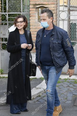 Stock Image of Simona Borioni  and Enzo Salvi ready to go during a short presentation of the new Pizza Girls series which will be broadcast on LA5 starting from February 15th in homage to the female figure.