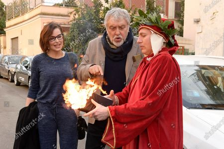 Simona Borioni and Maurizio Mattioli with a figurant who impersonates poet Dante Alighieri with the Divina comedy book during a short presentation of the new Pizza Girls series which will be broadcast on LA5 starting from February 15th in homage to the female figure.