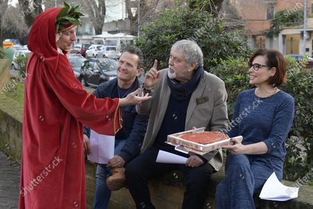 Simona Borioni, Maurizio Mattioli and Enzo Salvi with figurant who impersonates poet Dante Alighieri offering a pizza, during a short presentation of the new Pizza Girls series which will be broadcast on LA5 starting from February 15th in homage to the female figure.
