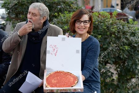 Stock Picture of Maurizio Mattioli and Simona Borioni showing the dedication made to women in the pizza box during a short presentation of the new Pizza Girls series which will be broadcast on LA5 starting from February 15th in homage to the female figure.