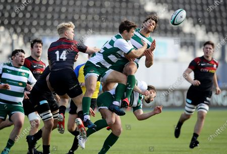 David Johnston and Dean Hammond of Ealing jump for the ball with Ben Harris of Saracens