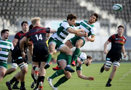 Stock Photo of David Johnston and Dean Hammond of Ealing jump for the ball with Ben Harris of Saracens