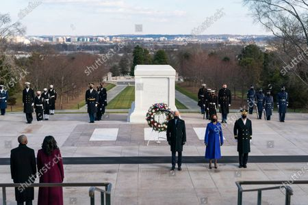 Stock Image of President Joe Biden and Vice President Kamala Harris participate in a wreath laying ceremony at the Tomb of the Unknown Soldier on Inauguration Day Wednesday, Jan. 20, 2021. at Arlington National Cemetery in Arlington, Virginia. Major General Omar J. Jones IV, Commanding General of the Military District of Washington, D.C. accompanies them. (Official White House Photo by Lawrence Jackson)