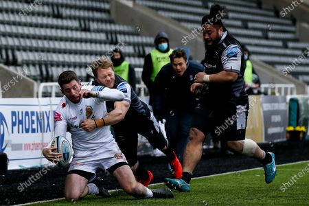 Alex Cuthbert of Exeter Chiefs is tackled