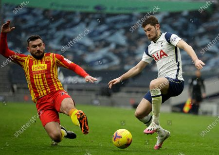 Tottenham's Ben Davies, right, duels for the ball with West Bromwich Albion's Robert Snodgrass during the English Premier League soccer match between Tottenham Hotspur and West Bromwich Albion at the Tottenham Hotspur Stadium in London