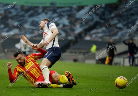 Stock Photo of Tottenham's Ben Davies, right, duels for the ball with West Bromwich Albion's Robert Snodgrass during the English Premier League soccer match between Tottenham Hotspur and West Bromwich Albion at the Tottenham Hotspur Stadium in London