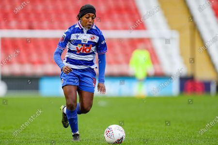 Reading forward Danielle Carter (18) runs with the ball during the FA Women's Super League match between Manchester United Women and Reading LFC at Leigh Sports Village, Leigh