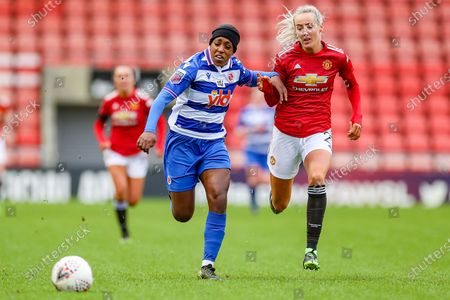 Reading forward Danielle Carter (18) and Manchester United defender Millie Turner (21) chase the ball during the FA Women's Super League match between Manchester United Women and Reading LFC at Leigh Sports Village, Leigh