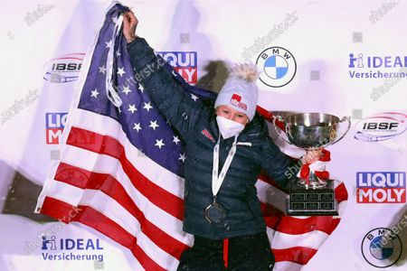 Stock Image of Kaillie Humphries of the United States celebrate after winning with Lolo Jones the two women's bobsleigh race at the Bobsleigh and Skeleton World Championships in Altenberg, Germany
