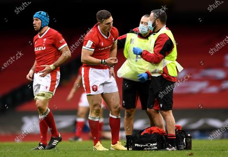Stock Photo of George North of Wales with physio John Miles and Dr Geoff Davies after taking a knock to the eye.
