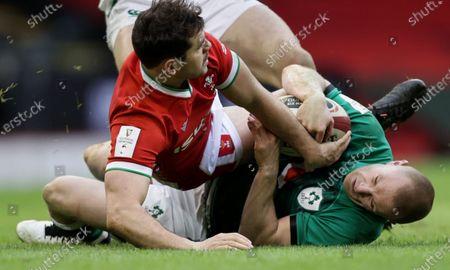 Wales vs Ireland. Ireland's Keith Earls and Tomos Williams of Wales
