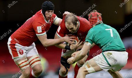 Stock Photo of Wales vs Ireland. Wales' Adam Beard and Alun Wyn Jones tackled by Josh Van der Flier of Ireland