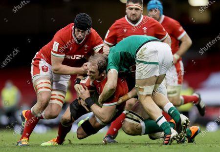 Stock Picture of Wales vs Ireland. Wales' Adam Beard and Alun Wyn Jones tackled by Josh Van der Flier of Ireland