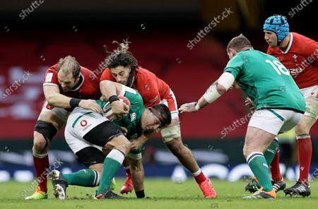 Wales vs Ireland. Wales' Alun Wyn Jones and Josh Navidi tackles CJ Stander of Ireland