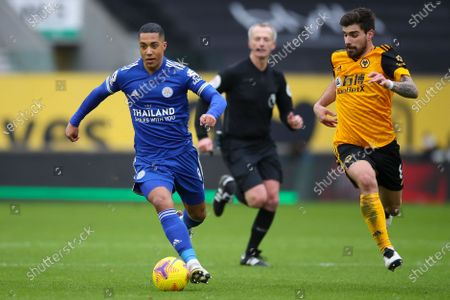 Wolverhampton Wanderers's Ruben Neves (R) in action against Leicester's Youri Tielemans (L) during the English Premier League soccer match between Wolverhampton Wanderers and Leicester City in Wolverhampton, Britain, 07 February 2021.