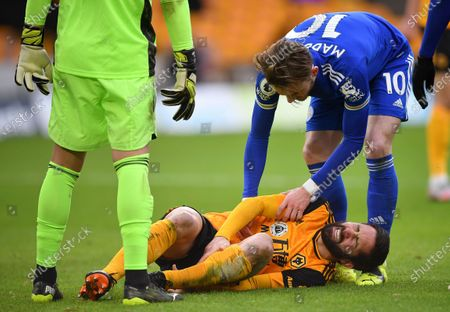 Wolverhampton Wanderers's Joao Moutinho (bottom) reacts in pain during the English Premier League soccer match between Wolverhampton Wanderers and Leicester City in Wolverhampton, Britain, 07 February 2021.