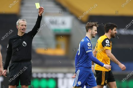 Leicester's James Maddison (C) is booked by referee Martin Atkinson (L) during the English Premier League soccer match between Wolverhampton Wanderers and Leicester City in Wolverhampton, Britain, 07 February 2021.