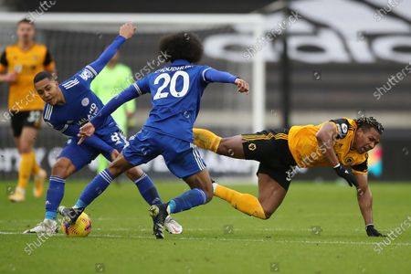 Wolverhampton Wanderers's Adama Traore (R) in action against Leicester's Youri Tielemans (L) and Hamza Choudhury (C) during the English Premier League soccer match between Wolverhampton Wanderers and Leicester City in Wolverhampton, Britain, 07 February 2021.