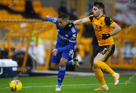 Wolverhampton Wanderers's Pedro Neto (R) in action against Leicester's Youri Tielemans (L) during the English Premier League soccer match between Wolverhampton Wanderers and Leicester City in Wolverhampton, Britain, 07 February 2021.