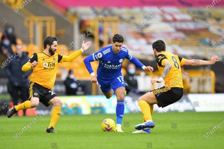 LeicesterÕs Ayoze Perez (C) in action against Wolverhampton Wanderers's Joao Moutinho (L) and Ruben Neves (R) during the English Premier League soccer match between Wolverhampton Wanderers and Leicester City in Wolverhampton, Britain, 07 February 2021.